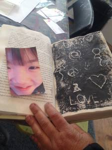 An example of a child's artwork using an old book at Art with Amy
