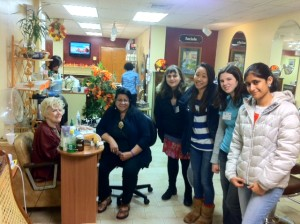 Volunteers from the BHS Food Justice Group, Jessica Lu & Ayesha Mehrota collecting donations and distributing containers for the Feed Brookline Drive. Pictured here with Maria Chavez, owner of Roman Coiffeurs and Kaylie Abner and Paola Pevzner, volunteers from Brookline Literacy Partnership.