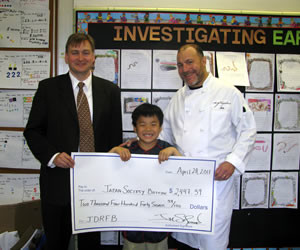 chef jim solomon of the fireplace with step son jack tuttle representing the devotion school